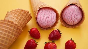 Strawberry ice cream in a waffle cone. Ice cream photo
