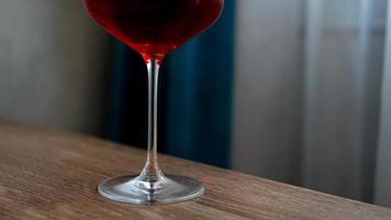 Long stem wine glass with red wine photo