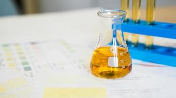 Flask and test tubes with urine on medical color schemes photo