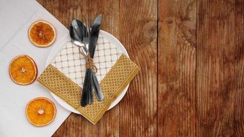 Overhead view of fall table setting over wooden table with copy space photo