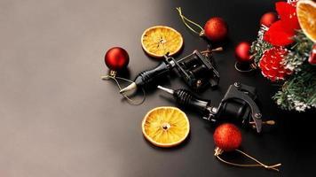 Tattoo machines on a christmas background - christmas decor photo