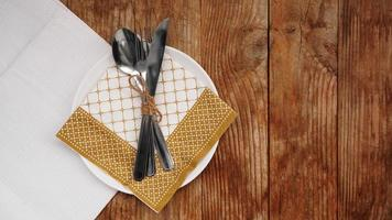 Place setting for dinner on rustic background. Top view. Copy space. photo