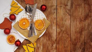 Overhead view of table setting over wooden table with copy space photo