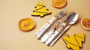 Setting of table with dry orange and wooden christmas figurines photo