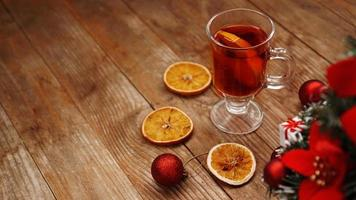 Christmas mulled wine in glass cup on a wooden table photo
