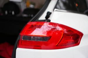 White car with headlight and open door photo