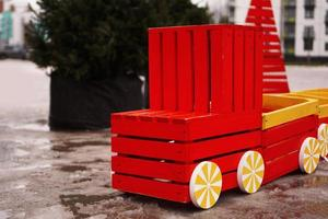 Wooden car on the playground. Winter, blurred background photo