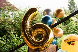 Composition of helium balloons gold and blue - large figure of six photo