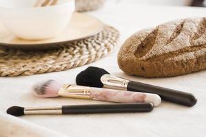 Makeup brushes on table. Light Scandinavian style kitchen photo