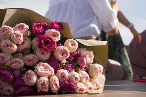 Colorful pink roses bouquet, soft and airy natural background photo