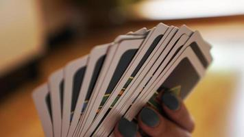 People playing cards. Hand with cards on blurred background photo