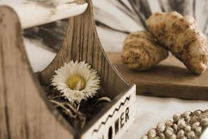 Dried flower in a wooden box on the table. Scandinavian style photo