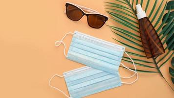 Sunglasses, protection spf cream, medical masks. Beach accessory photo