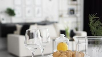 Empty wine glasses on blurred background of modern interior photo