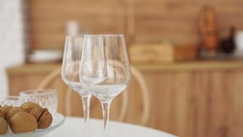 Empty wine glasses on wooden interior photo