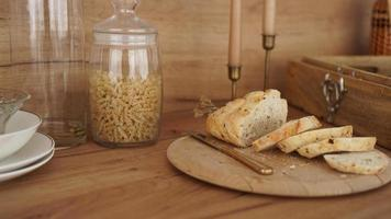 Sliced white bread on a wooden tray. Modern Scandinavian style kitchen photo