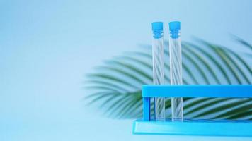 Test tubes on a blue background. Tropical leaf. Tropical disease photo