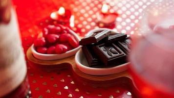 Valentines day. Bottle of vine, glasses, red rose photo
