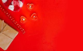 Top view - festive red background for Valentine Day photo