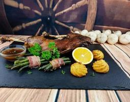Roasted goose with beans and duchess potatoes photo