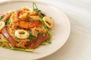 Stir-fried rice vermicelli and water mimosa with mix seafood photo