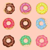 Set of sweet donuts with cream isolated on a pink background. vector