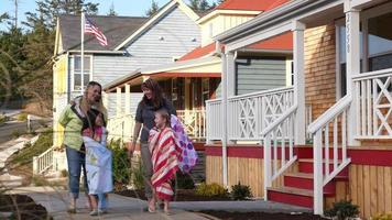 People walking in coastal community video