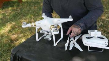 Man preparing drone for flight video