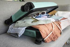 The arrangement clothes accessories suitcase photo