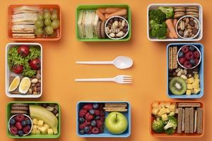Healthy food lunch boxes with cutlery photo