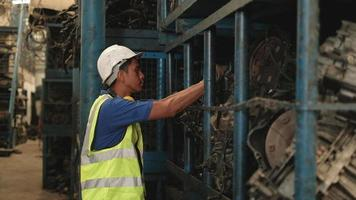 Young Asian male worker in safety uniform at factory warehouse video