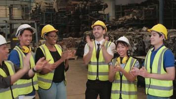 Various ethnic workers and engineers in factory warehouse video