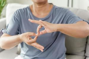 Deaf disabled woman using Sign Language communicate to other people. photo