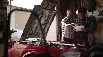 Two Mechanics in Garage Repair Room video