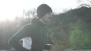 Young Runner Training on The Beach in The Morning video