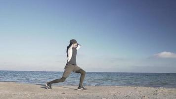 Young Male Runner Training on The Beach in Cold Weather video