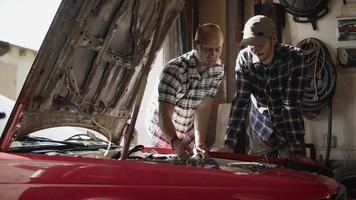 Two Mechanics in The Workroom video