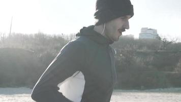Male Runner Training on The Beach in Cold Weather video