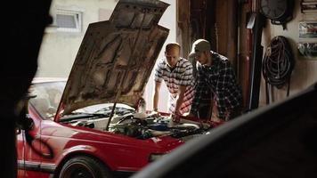 Mechanics Repairing a Car Engine in The Workroom video
