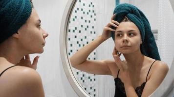 Young woman has problems with skin on the face photo