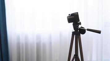 Camera on a tripod indoors. Filming a video blog photo