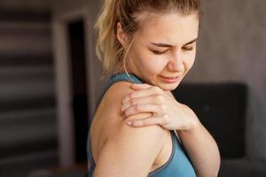 Women wearing athletic suits feeling shoulder pain after exercise photo