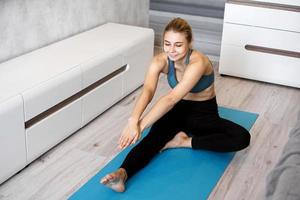 Sport, training and lifestyle concept - woman stretching photo