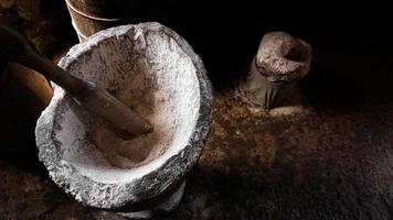 Ancient flour mortar. Wooden vessel for manual hand grinding photo