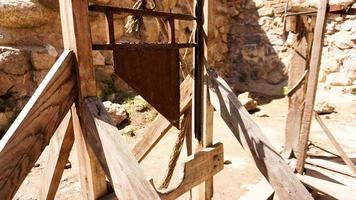An old guillotine made of wooden planks and an iron blade photo
