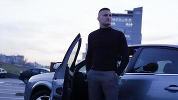 Handsome businessman near the car in the city photo