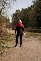 A man in sportswear on a forest path photo