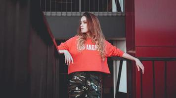 Fashion model wearing red hoodie with inscription los angeles photo