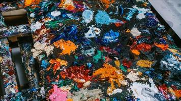 Imagen de fondo de brillante paleta de pintura al óleo closeup foto