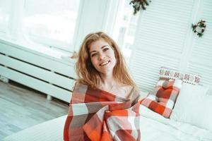 A beautiful young Russian woman in a red plaid photo